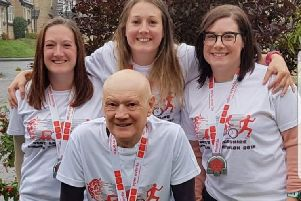 Nick Dinsdale after finishing his first ever triathlon with his three daughters Helen, Michelle, and Nicola.