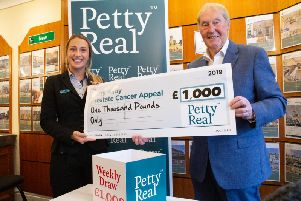 Barry Kilby receives 1,000 from Charlotte Hagan, Chair at Petty Real