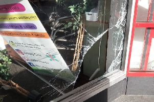 The smashed in window at Krafty Cow tea room