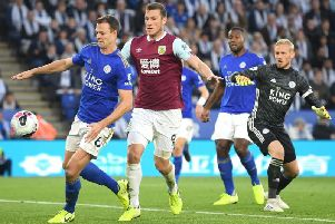 Jonny Evans turns the ball in to his own net under pressure from Burnley's Chris Wood, but the goal is chalked off following a VAR check