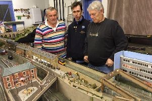 Society members John Dodds, Anthony Ward, and Peter Wainman test running Ecclesford Junction for the exhibition.
