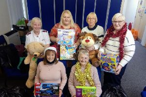 Members of the Salvation Army in Burnley with the Christmas Toy Appeal presents