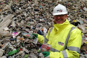 William Maxwell, Lancashire County Council's waste service manager, with some examples of the plastic pots and tubs which can now be recycled in household waste....