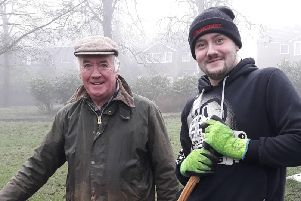New volunteer Adam Duerden learns ropes from volunteer co-ordinator David Pickles as he joins the ranks of Friends of Ightenhill Park.