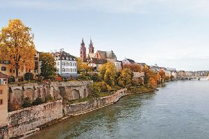 The shore of the Rhine on the Grossbasel side with a view of the cathedral and the Mittlere Brcke in the background. Copyright Basel Tourismus
