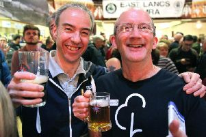 Drinkers enjoy a pint in Colne