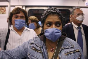 Commuters wear masks as a precaution against infection inside a subway in Mexico City, in April 2009, after swine flu claimed the lives of 60 people