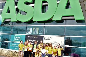 Clayton Harriers' juniors before their bag pack at the Burnley Asda store.