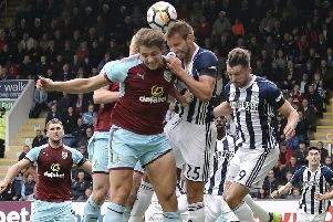 Burnley's James Tarkowski battles with West Bromwich Albion's Craig Dawson