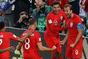 England captain Harry Kane celebrates scoring from the spot against Colombia