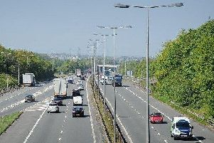 The M65 has been closed by police between junctions six and five