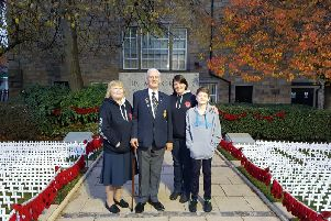 Jenny Guest with Luke and her parents, Ken and Barbara Neild, at their final monument in Burnley's Peace Garden.