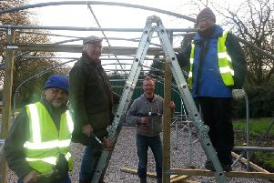 Volunteers from the Friends of Ightenhill Park group at work on the polytunnels to protect their plants and vegetables.