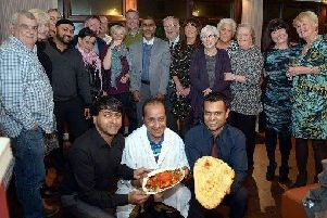 Guests and organisers at last year's curry night at the Usha in aid of the charity Emmaus.