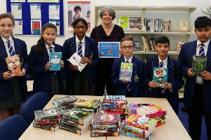 Librarian Mrs Halstead with pupils at Blessed Trinity RC College and some of the books they won in the James Patterson Big Book giveaway competition.
