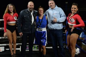 Cathy Dickinson (centre) in blue pictured at her boxing match with husband Micheal  and Russell Jarmesty  (photo: Grant Sullivan)