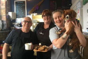 Pictured at the launch of the doggy afternoon teas are (from left to right) Sanwitches cafe owners David and Christine Moore with Diane Murphy the owner of Millie and Ruby's dog baker with Pippa.