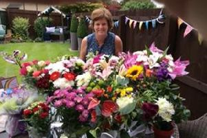 Mrs Janet Ennis with flowers she had received from staff and pupils on her final day at Padiham Green