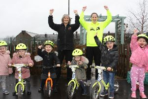Sarah Darcy (right) and head teacher Gail Murphy with some of the youngsters at Taywood Nursery School who have taken part in the bike scheme.