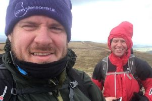 Andy (front) with his pal Stewart Bromwich after they completed the walk from Worsthorne to the top of Pendle Hill for World Kidney Day.