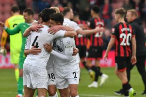 Jack Cork, Ashley Westwood and Matt Lowton celebrate at full time. Photo: Andy Ford/Burnley FC