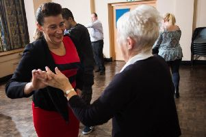 Michelle Hurlstone (left), Independent Living Officer for Calico Homes, practices her dance moves.