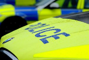 Police arrested two people at a house in Nelson