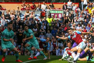 Burnley's Matthew Lowton sees his shot blocked by Arsenal defender Shkodran Mustafi in the final game of the season at Turf Moor