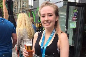 Jodie in celebration mode after completing the Manchester 10k to raise 700 plus for charity.