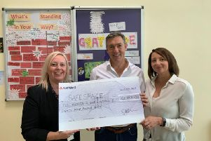 Steve and Lisa Nicholas (right), event organisers of the Fence Charity Ball, handing over a cheque for 10,184 to Claire Bennet, charity manager of SafeSpace. (s)