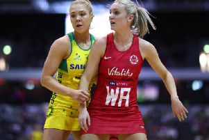 Kate Moloney of Australia in action against Natalie Haythornthwaite of England during the Vitality Netball International Series match between England Vitality Roses and Australian Diamonds, as part of the Netball Quad Series at Copper Box Arena