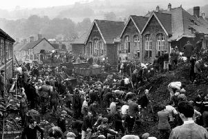 Rescue workers searching for victims of the Aberfan Disaster of 1966, which killed 144 people, including 116 children.