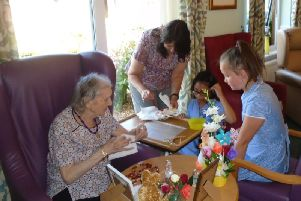 Schoolchildren, staff and residents at Dove Court