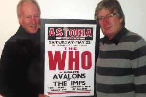 David Parkinson and Mike Guttridge holding the poster of The Who, a band The Avalons supported at the Astoria Ballroom in the early 1960's.