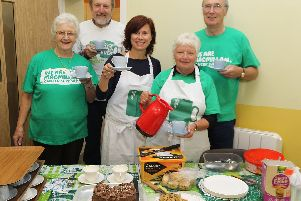 Carol Allcock, Keith Dolbar, Carol and Ann Mayo and Alan Phillips at the coffee morning in Chelmorton for Macmillan Cancer Support. Photo: Jason Chadwick.