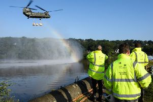 An RAF Chinook helicopter was brought in to drop aggregate into the damaged dam. Photo - Leon Neal/Getty Images