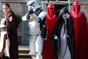 Star Wars characters welcoming visitors to the Dome