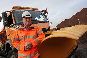 Councillor Simon Spencer, Derbyshire County Council Cabinet Member for Highways, Transport and Infrastructure checks the grit stocks at Chesterfield's Stonegravels depot.