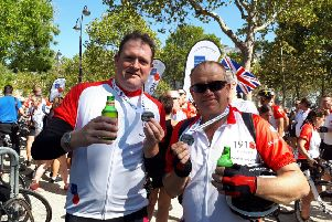 Paul Copper, left, and Alan Tideswell, right, having just finished the Pedal to Paris to raise funds for the Royal British Legion's Poppy Appeal.