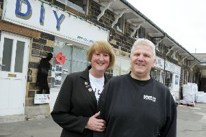 Sally Tideswell, the secretary and Poppy Appeal organiser for the Chapel en le Frith branch of the RBL pictured with Paul Carrington, the owner of Chapel DIY, who were the first business in Chapel to support the silent soldier silhouette scheme.