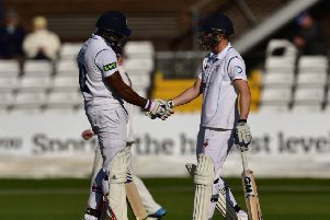 Chesney Hughes and Ben Slater celebrate their 50 run opening partnership during Derbyshire County Cricket Club second innings at 3aaa County ground, Derby on 11 May 2015.  Photo: Simon Trafford