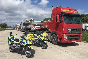 Derbyshire Roads Policing Unit bikes with a wideload