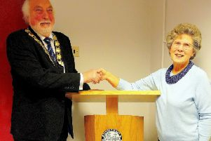 Mike Evanson, Chairman of Chapel-en-le-Frith Parish Council, accepting the gift of a new lectern for Chapel-en-le-Frith Town Hall from Mrs Beryl Martin.