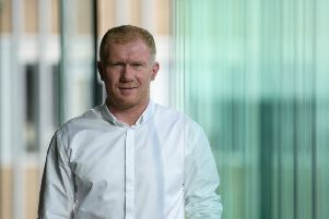 New Oldham boss Paul Scholes knows he has the very best help at hand.  (Photo by Anthony WALLACE / AFP)