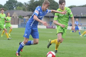 Striker Bradley Grayson, who scored two goals and made the other.