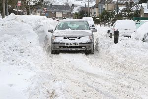 Days of heavy snow led to huge drifts like this one on Bench Road in Fairfield