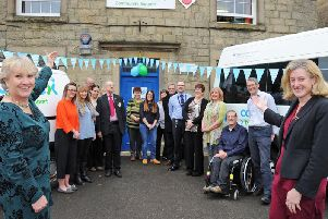 Gill Geddes, left, the chief executive of Connex Community Support and MP Ruth George, right, pictured with staff and invited guests at the launch of the re-named community charity on Buxton Market Place on Friday. Photo: Anne Shelley.