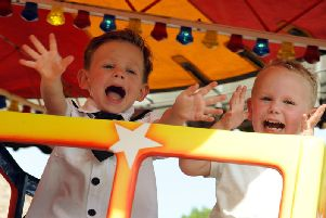 Youngsters enjoy the rides on offer.