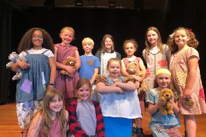 The cast of Annie.