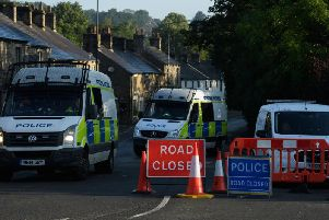 Police vehicles block the road in Whaley Bridge. Photo by Leon Neal/Getty Images.
